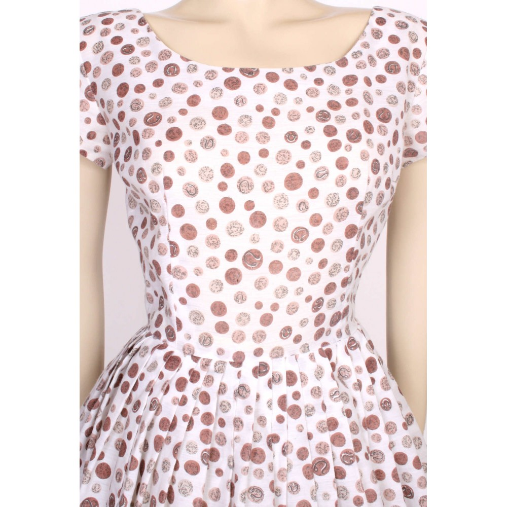 Spotty printed tea dress made from a slinky stretch fabric. Scoop neckline with small keyhole feature to the back. Panelled skirt in a floaty A line.